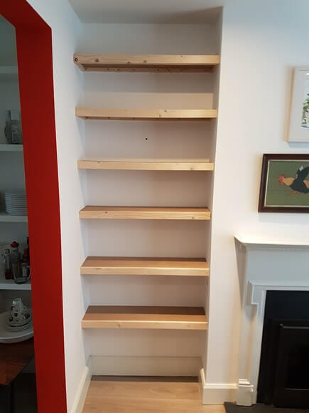 Inexpensive floating shelves.  Made with solid pine and mdf.