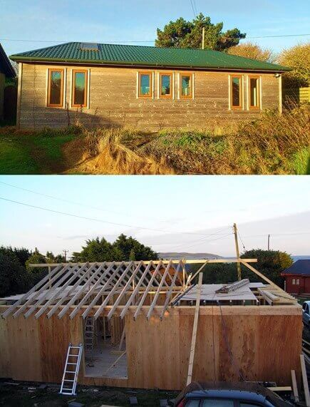 a timber frame house being built with a hipped roof being framed.