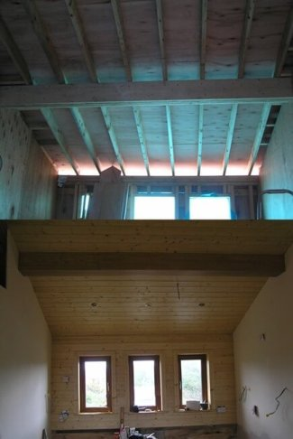 this roof is an open design. the ceiling in the living room, finishes at the roof ridge and the supporting purlin is also visible. Cladding has been used to cover the perlin, and the ceiling has been cladded in timber also.