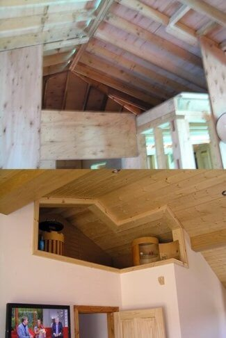the exposed roofing rafters and the same area finished and decorated