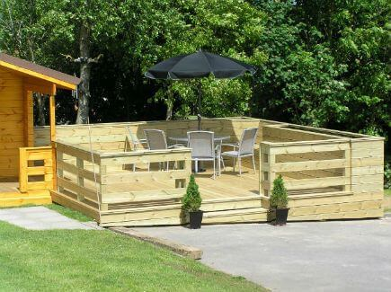 This deck was built using pressure treated Scandinavian Spruce. Seating and planter boxes have been built into the design, these also help to shelter the deck on windy days. A solid frame built with 6x2 pressure treated timber joists and resting on concrete piers(no wood is in contact with the soil). This insures a longer lifespan.