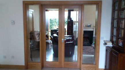 The glazed double doors with side panels were made to order, then fitted. They work well maintaining an open space on the ground floor of this house.