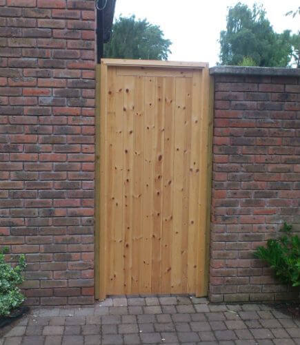 A solid pine door with mortice lock, and full frame.