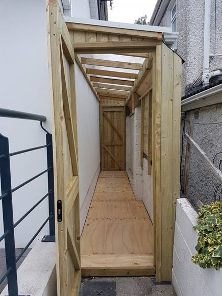 This side passage shed utilises the full width of the side passage.  With a damp proof floor made from 18mm plywood, joists, damp course and vents.  The doors are fitted with 5 lever dead bolts for security.