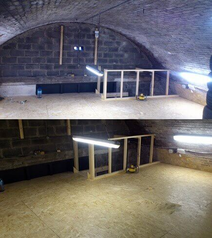 The constructed mezzanine floor,in the top half of the archway. Six by two joisting and three quarter inch osb board were used to floor this area out. The joisting is supported by the heavy duty racking beneath.