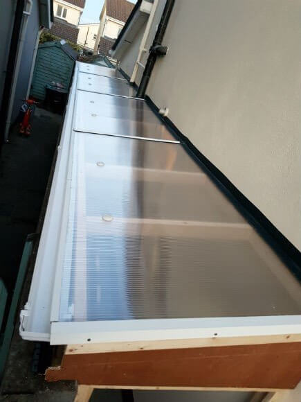 The roof material used on this roof over side passage is 10mm twin wall polycarbonate sheeting. Very strong, durable, all accessories are also available for this product, leaving a well sealed tidy structure. Ideal for storage with the walls shelved out.