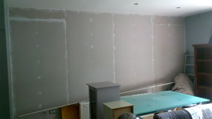A plasterboarded wall cmpletely sealed with acoustical sealant.