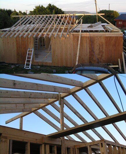 The hipped roof is now being constructed using 2x6 inch rafters. The second image is taken from inside of the, to be timber frame house, where the living space is open to the roof ridge with the use of purlin beams to support.