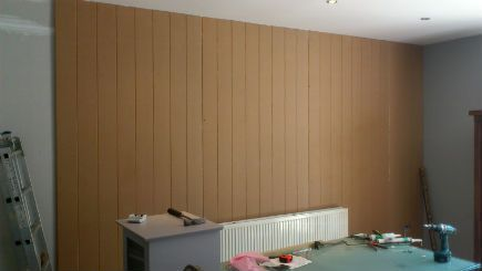 wall panelling before the decorating has taken place.